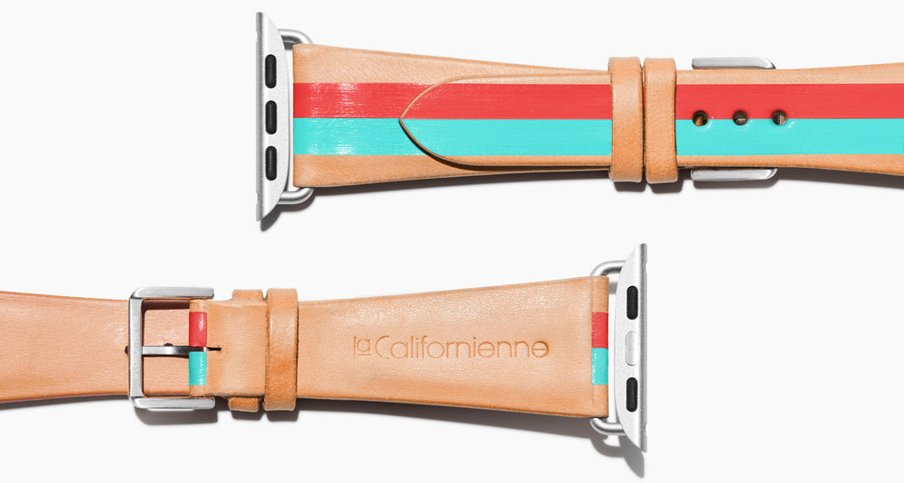 natural vegetable tanned leather with two hand-painted stripes in red mad aqua in women's length which measures: 105mm and 65mm. Hardware offered in gold, black, or silver in the small and large size. Please reach out with any questions. Price $400 plus shipping.