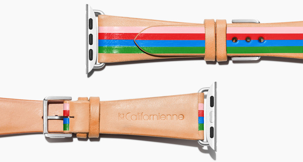 Strap for the Apple Watch handmade of natural vegetable tanned leather with four hand-painted stripes in pink, red, blue, kelly green in women's length which measures: 105mm and 65mm. Hardware offered in gold, black, or silver in the small and large size. Price $400 plus shipping. Please reach out with any questions.