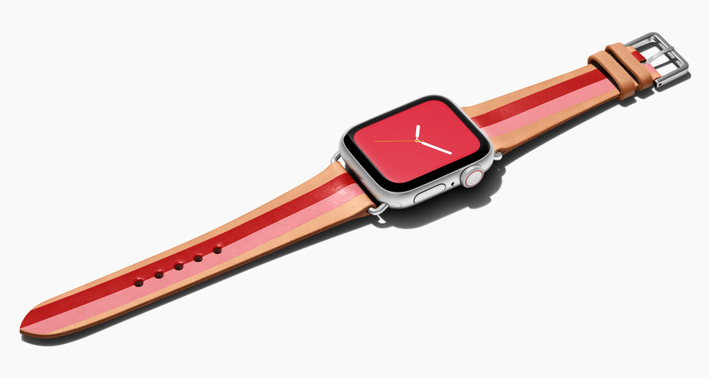 Strap for the Apple Watch handmade of natural vegetable tanned leather with two hand-painted stripes in red and pink  in women's length which measures: 105mm and 65mm. Hardware offered in gold, black, or silver in the small and large size. Price $400 plus shipping. Please reach out with any questions.