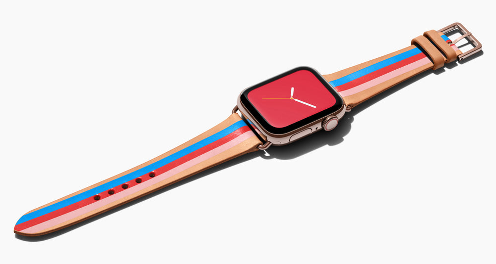 Strap for the Apple Watch handmade of natural vegetable tanned leather with three hand-painted stripes in bright blue, red, and petal pink in women's length which measures: 105mm and 65mm. Hardware offered in gold, black, or silver in the small and large size. Price $400 plus shipping. Please reach out with any questions.