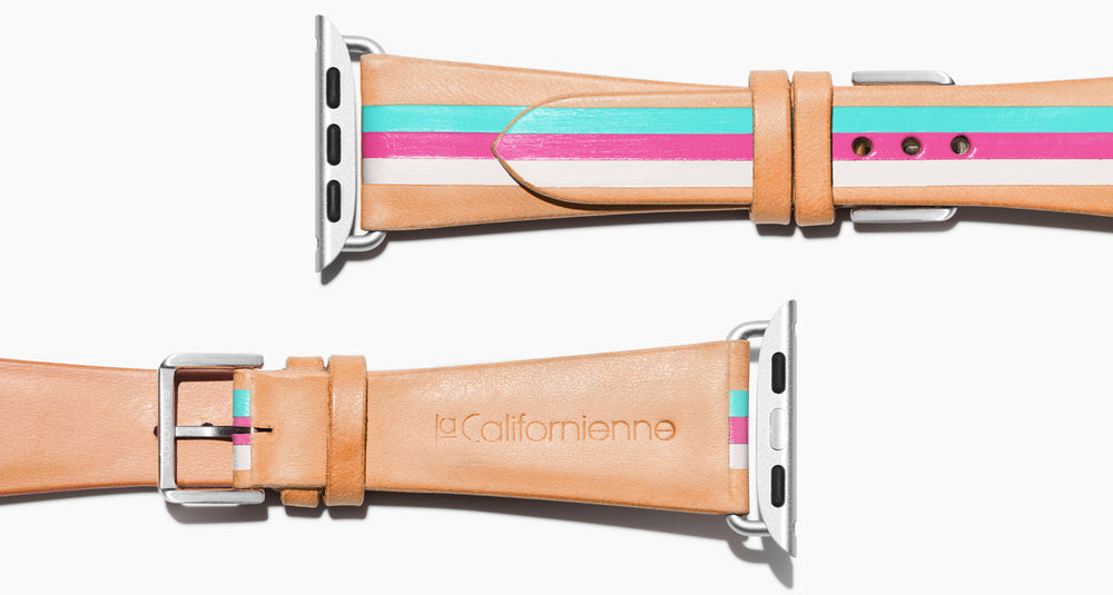 Strap for the Apple Watch handmade of natural vegetable tanned leather with three hand-painted stripes in aqua, hot pink, and white in women's length which measures: 105mm and 65mm. Hardware offered in gold, black, or silver in the small and large size. Price $400 plus shipping. Please reach out with any questions.
