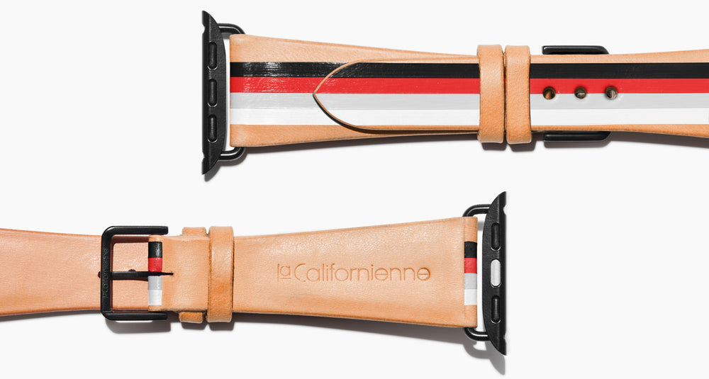Strap for the Apple Watch handmade of natural vegetable tanned leather with four hand-painted stripes in black, red, grey, white in men's length which measures: 105mm and 75mm. Hardware offered in gold, black, or silver in the small and large size. Price $400 plus shipping. Please reach out with any questions.