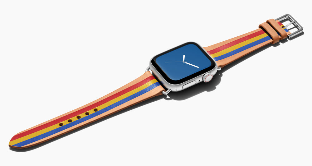 Strap for the Apple Watch handmade of natural vegetable tanned leather with three hand-painted stripes in red/ yellow, blue in men's length which measures: 105mm / 75mm. Hardware offered in gold, black, or silver in the small and large size. Price $400 plus shipping. Please reach out with any questions.