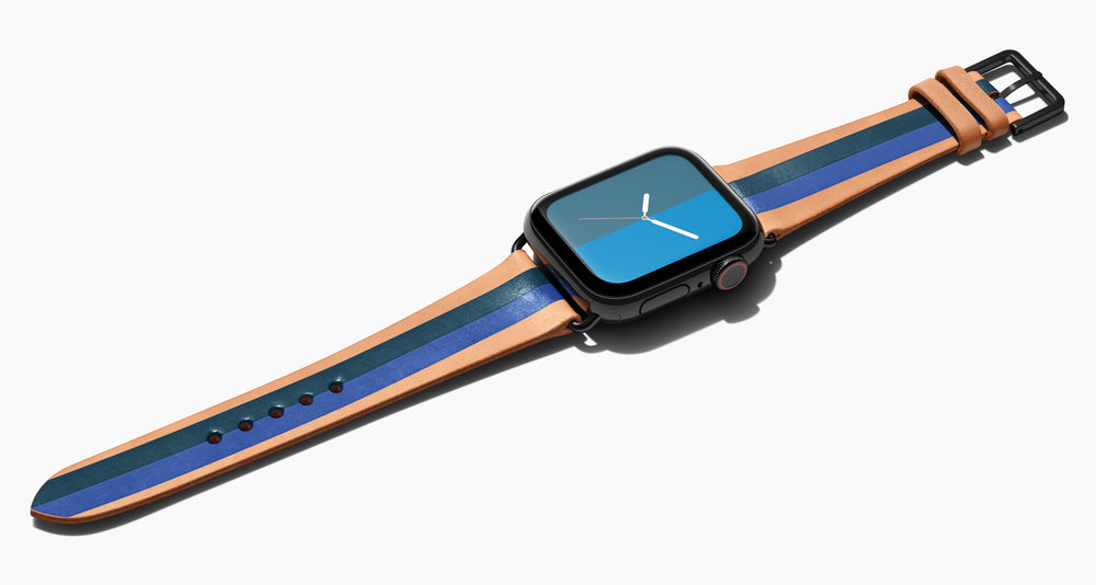 trap for the Apple Watch handmade of natural vegetable tanned leather with two hand-painted stripes in dark teal blue and a lighter softer blue in men's length which measures: 105mm / 75mm.  Hardware offered in gold, black, or silver in the small and large size. Price $400 plus shipping. Please reach out with any questions.