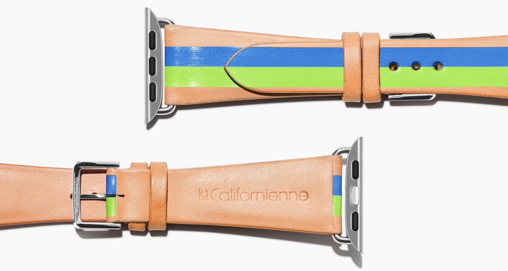 Strap for the Apple Watch handmade of natural vegetable tanned leather with two hand-painted stripes in rime green and bight blue in men's length which measures: 105mm / 75mm.  Hardware offered in gold, black, or silver in the small and large size. Price $400 plus shipping. Please reach out with any questions.