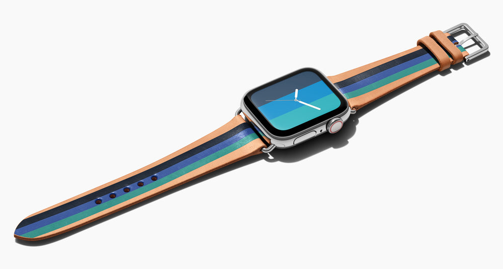 Strap for the Apple Watch handmade of natural vegetable tanned leather with three hand-painted stripes in navy, bright blue, teal in men's length which measures: 105mm / 75mm. Hardware offered in gold, black, or silver in the small and large size. Price $400 plus shipping. Please reach out with any questions.