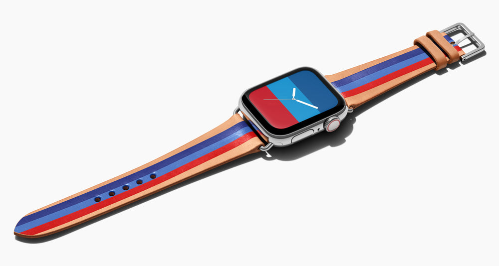 Strap for the Apple Watch handmade of natural vegetable tanned leather with three hand-painted stripes in navy, bright blue, red in men's length which measures: 105mm / 75mm. Hardware offered in gold, black, or silver in the small and large size. Price $400 plus shipping. Please reach out with any questions.