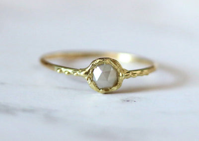 stacking gold ring with gray diamond