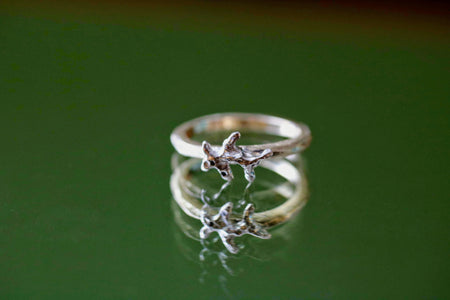 silver coral reef with gold ring