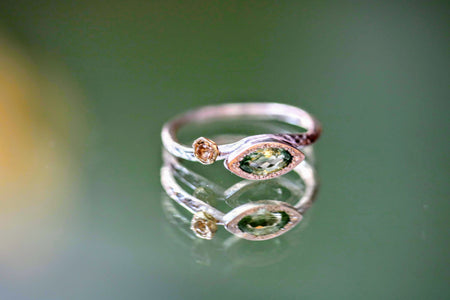 light green tourmaline marquise ring in silver and moonstone with 18k yellow gold