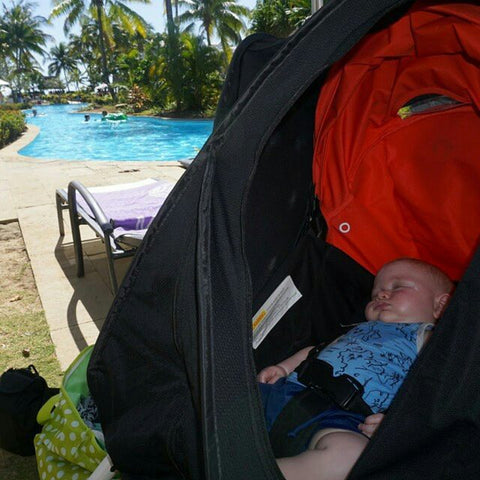 cozigo stroller cover by the pool