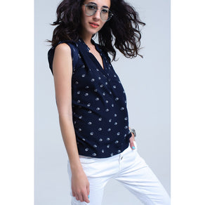 Navy print blouse with V neck and ruffle detail