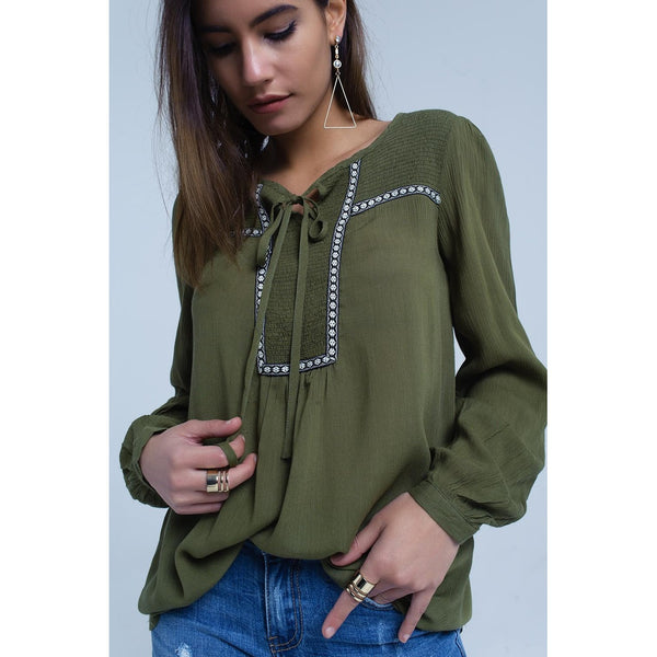 Green blouse with embroidered trims