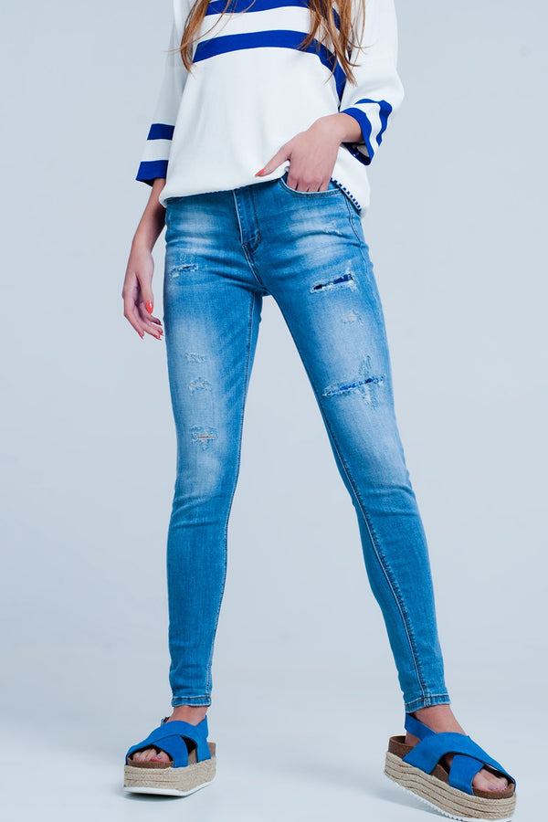 Slim Fit Stretch Jean In Mid Blue With Rip & Repair