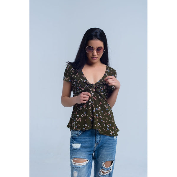 Green top with floral print