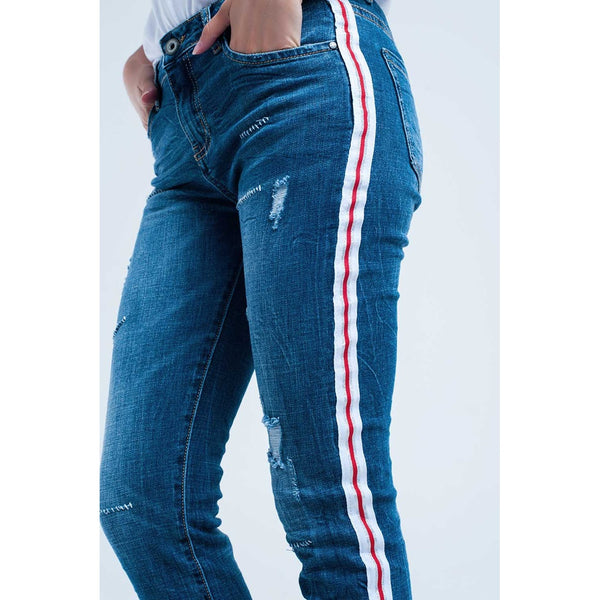 Jeans with rips with white and red sideline