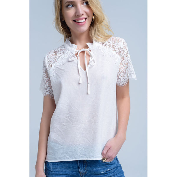 Cream blouse with lace insert