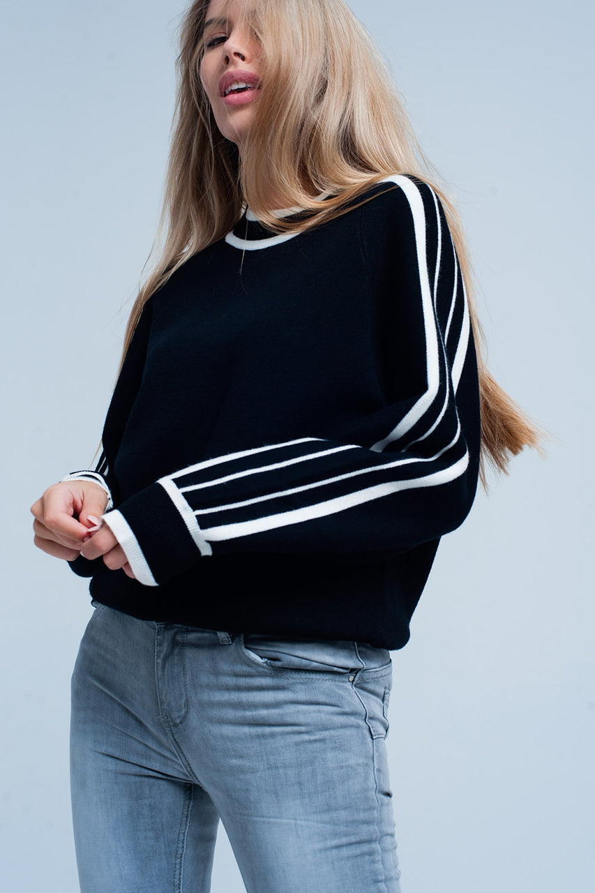 Black sweater with striped sleeves