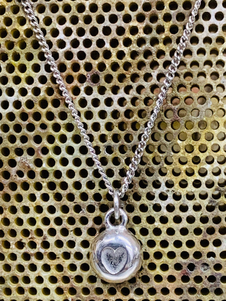Heart nugget pendant sterling silver close curb chain 7mm diameter.