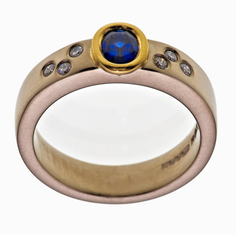 Oval Cut 1.2ct Sapphire Set 18ct. Yellow Gold 4.5mm Platinum Band Brilliant Cut Diamonds 0.20ct - David Smith Jewellery