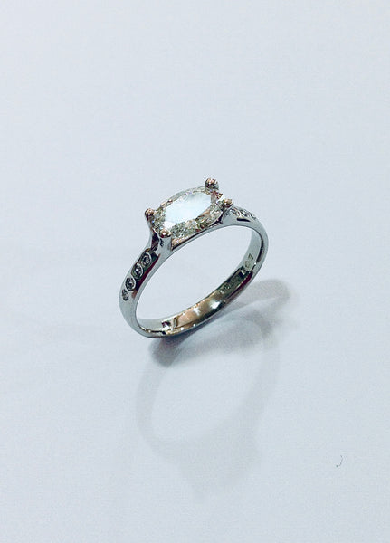 Oval Diamond set in David Smith signature 4Claw Platinum Engagement Ring. Diamond G colour, VS1 clarity, with flush set graduated brilliants to the shoulders. 3pt, 2pt, 1pt and 1/2pt each side with total weight of principle stone and accents 1.30 carat. Available in all finger sizes.