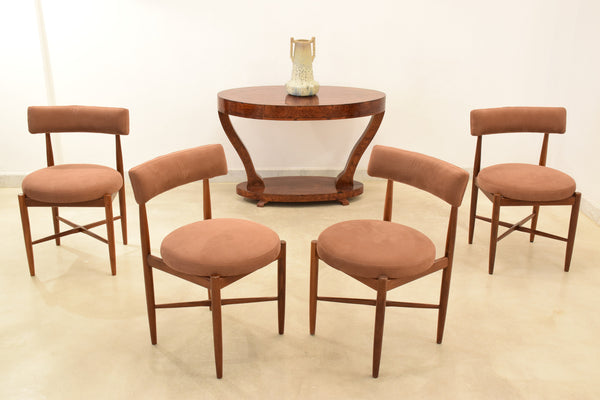 A set of 5 G Plan dining chairs designed by V B Wilkins at the end of the 1960's as part of the Fresco range. Each chair has sculpted tapered legs and cross shapes stretchers. The circular backs and round circle seat pad cushions are re-upholstered in Lelievre Paris in a cotton subtle matt robust twill.
