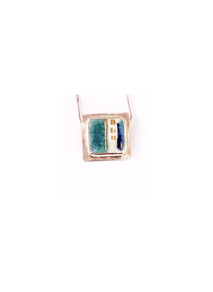 Pendentif turquoise lustre d'or