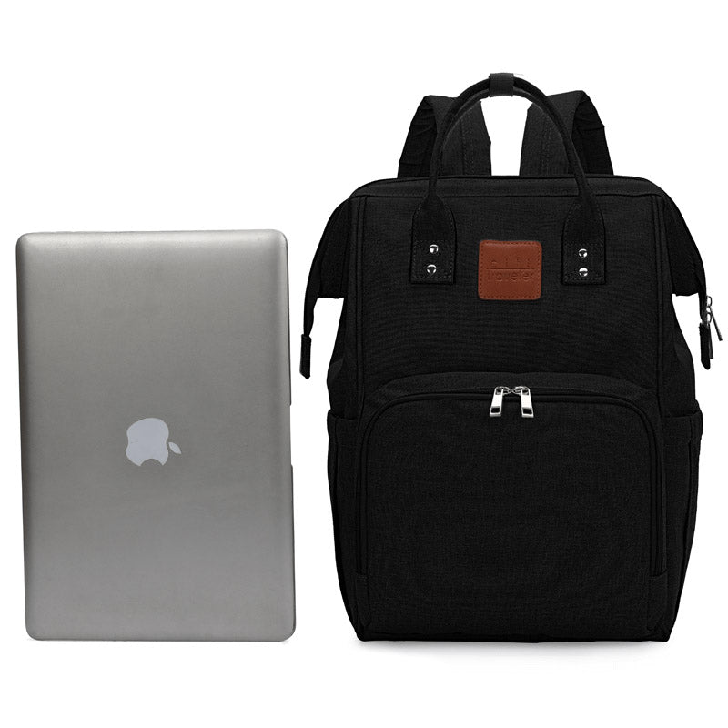 Black Traveler Backpack and Diaper Bag by Citi Collective Front View Next To Laptop