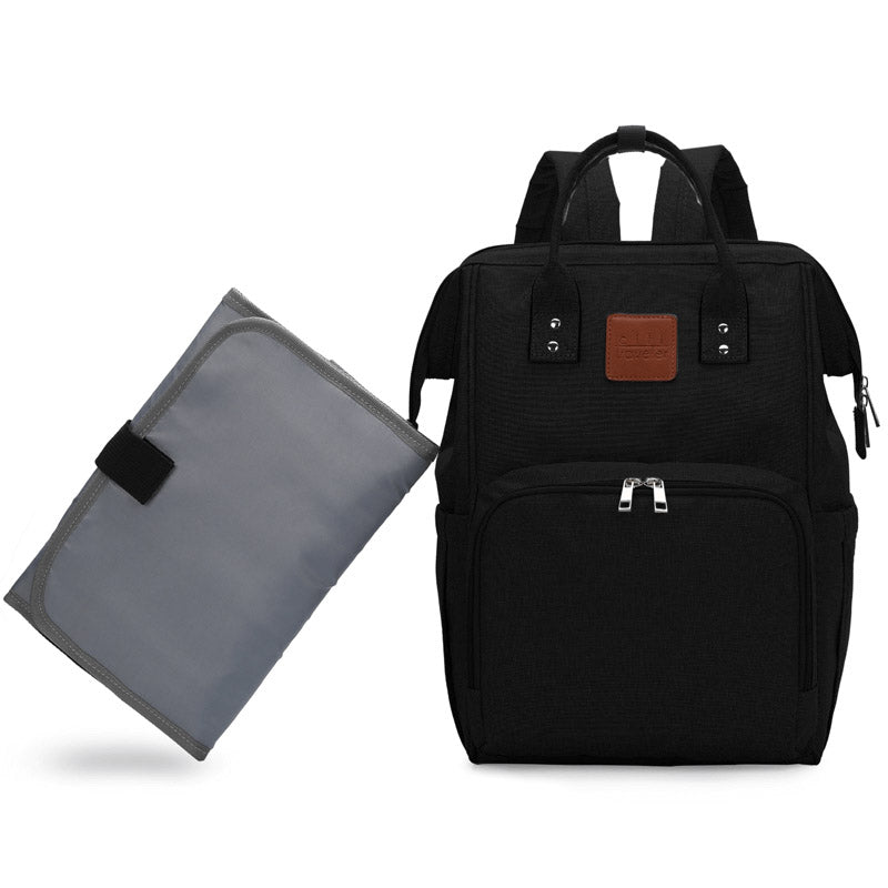 Black Traveler Backpack and Diaper Bag by Citi Collective Front View Next To Changing Pad