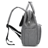 Grey Traveler Backpack and Diaper Bag by Citi Collective Side View