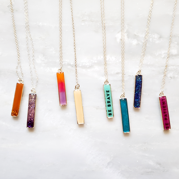 variety of bar necklaces by Kate and Moose