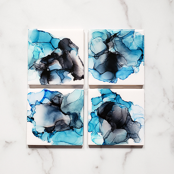 variegated black and blue alcohol ink on ceramic coasters