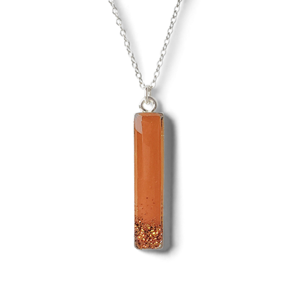 burnt orange with glitter pewter vertical bar necklace by Kate and Moose