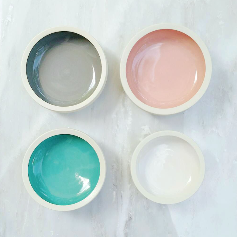 gray, salmon pink, teal and white ceramic dish