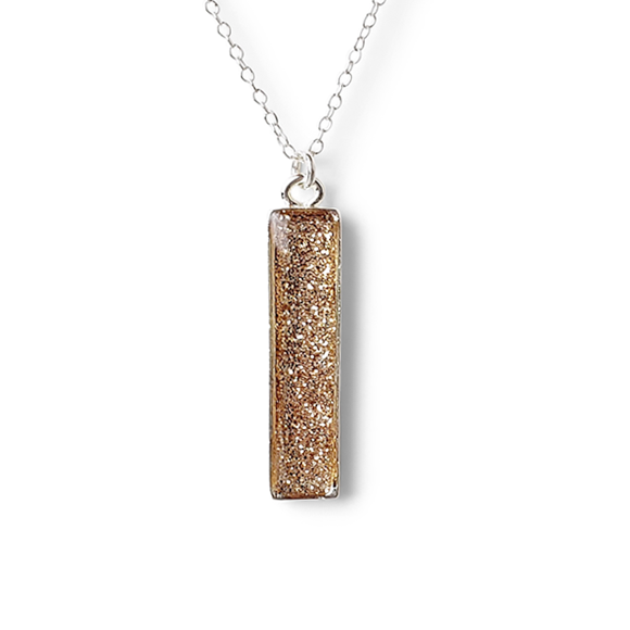 gold and silver glitter in pewter vertical bar necklace by Kate and Moose