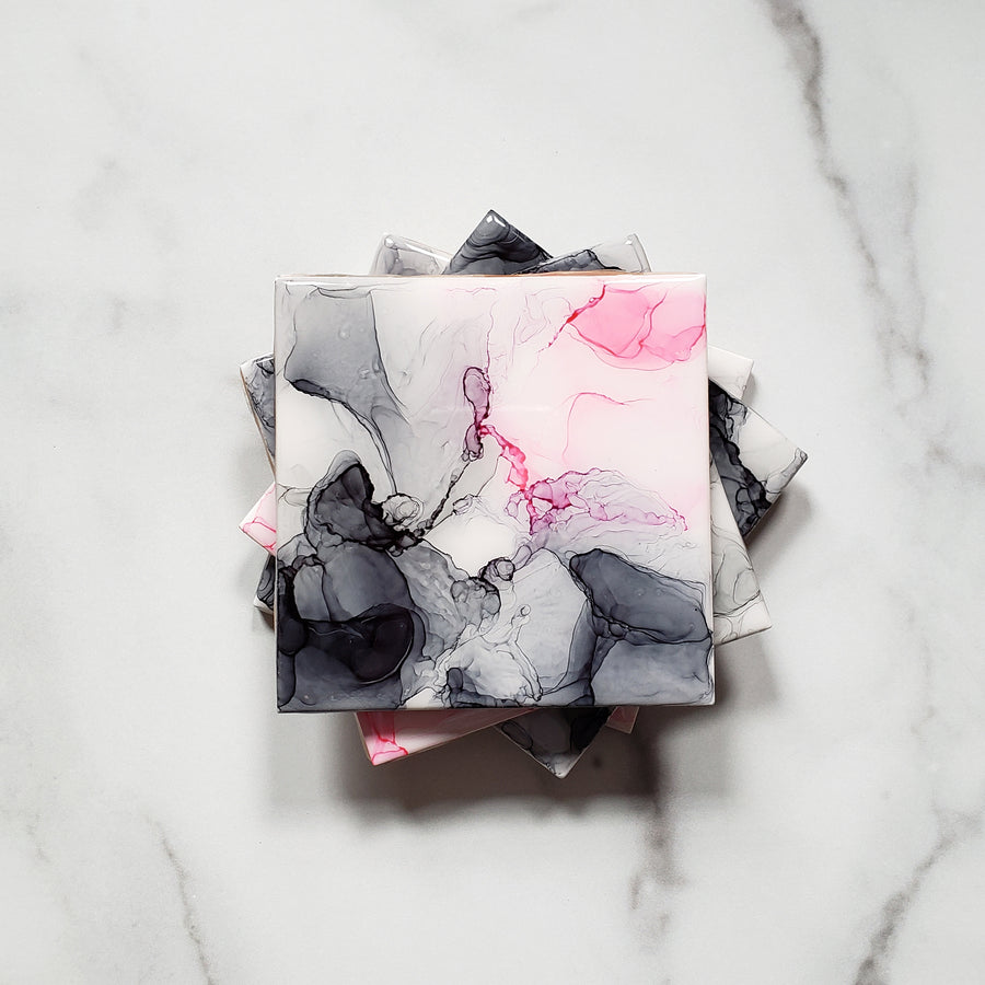 shades of gray and pink alcohol ink on ceramic coasters