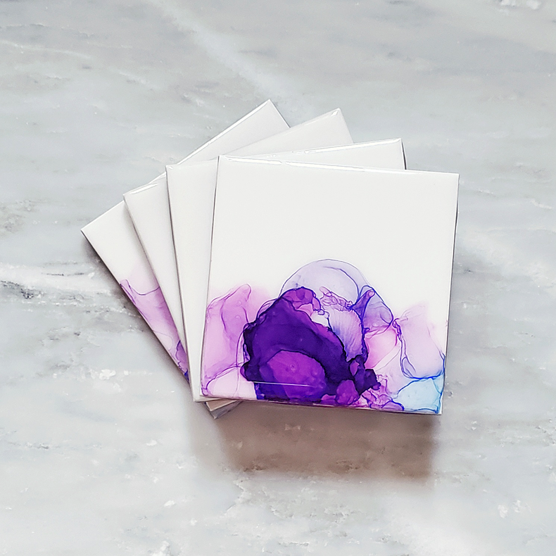 pink, purple, and blue alcohol ink on ceramic coasters by Kate and Moose