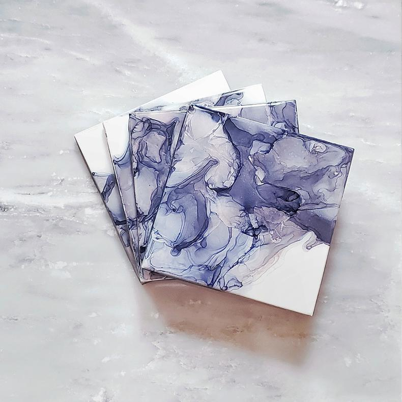 purple and rose gold alcohol ink ceramic coasters by Kate and Moose
