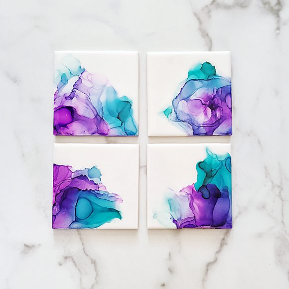 purple and teal alcohol ink ceramic coasters by Kate and Moose