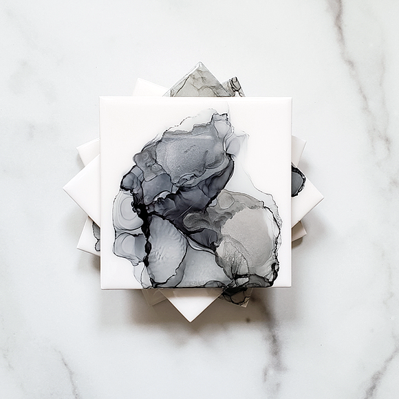ceramic drink coasters in shades of gray