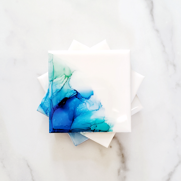turquoise alcohol ink ceramic coasters by Kate and Moose