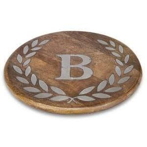 Add your personalized touch to every meal with our chic Heritage Wood & Metal Inlay Monogram Round Trivet by the GG Collection!