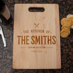 Designs by MyUtopia Shout Out:Cooking up A Storm Personalized with Family Name and Year Cutting Board