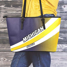 Load image into Gallery viewer, Designs by MyUtopia Shout Out:#GoBlue Michigan Faux Leather Totebag Purse,Medium (10 x 16 x 5) / Black/Yellow/Blue,tote bag purse