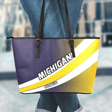 Load image into Gallery viewer, Designs by MyUtopia Shout Out:#GoBlue Michigan Faux Leather Totebag Purse,Large (11 x 17 x 6) / Black/Yellow/Blue,tote bag purse