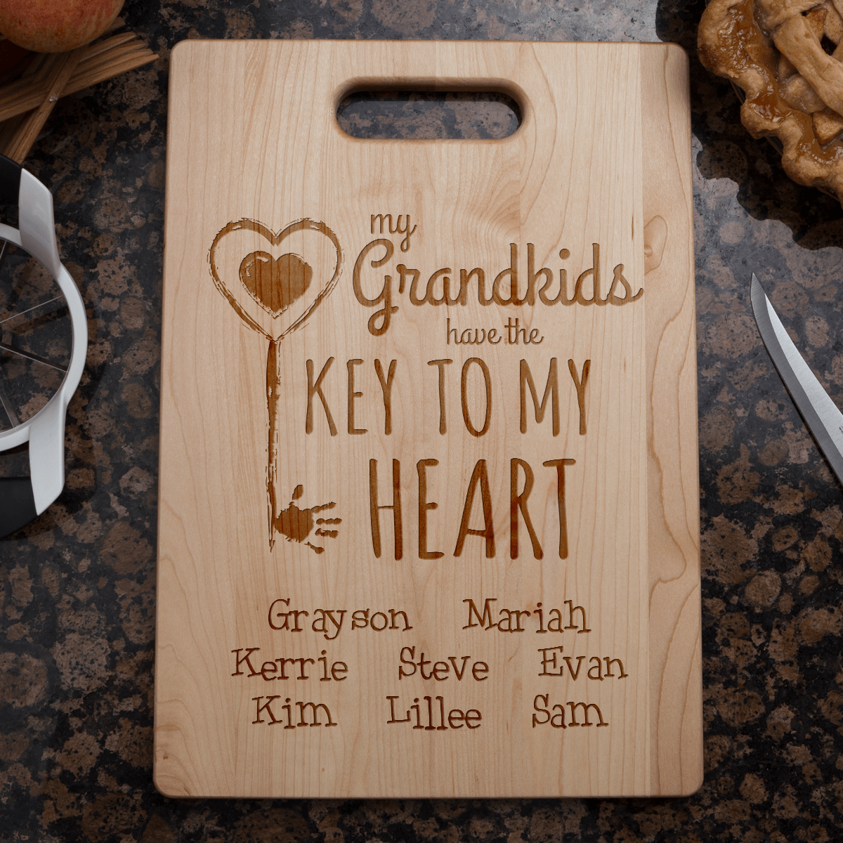 Designs by MyUtopia Shout Out:Key To Grandma's Heart Engraved Cutting Board Personalized Gift