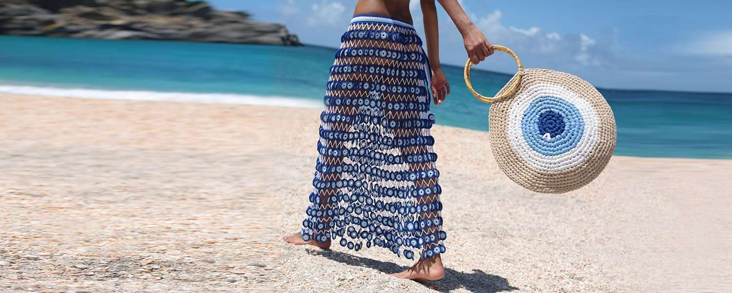 hand crocheted dresses, evil eye, beachwear, resort wear, boho-chic, coachella, luxury resort wear, sustainable fashion, fair-trade fashion, ethical fashion, gypset style, beach bags, tote bags, beach accessories, boho lux, destination wedding dress, boho wedding dress, beach wedding dress, honeymoon outfit ideas, swimsuit, bikini, cover-up, kaftan, sandals, one shoulder dress, strapless dress, off the shoulder dress, strapped dress, crop top, one piece bathing suit, belted dress, wrap skirt, fringe bag, island chic, summer vacation dress, crochet bikini, crochet beachwear