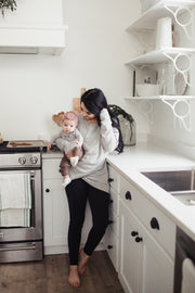 mom in kitchen holding baby