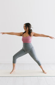 Postpartum athletic woman in warrior yoga pose