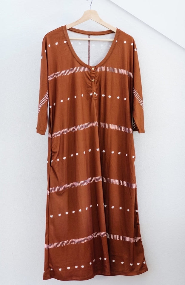 Brown midi dress with white stripes on hanger